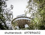 UFO tower detail, part of Bridge SNP over Danube river in Bratislava city, Slovakia, hidden behind trees - stock photo