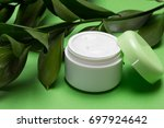 open jar of moisturizing cream... | Shutterstock . vector #697924642