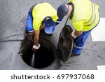 Sewerage Workers  Draining The...