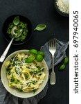 tagliatelle with basil pesto... | Shutterstock . vector #697940065