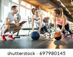 two sporty girls exercising... | Shutterstock . vector #697980145