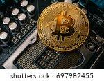 golden bitcoin at printed... | Shutterstock . vector #697982455