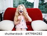 cute little girl with paper... | Shutterstock . vector #697984282