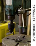 Small photo of drilling machine head and drill chuck key