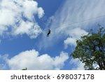 zipline is an exciting... | Shutterstock . vector #698037178