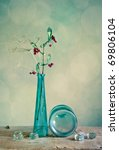 Still Life with glass vase and berries - stock photo