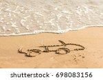 draw car on beach sand.... | Shutterstock . vector #698083156