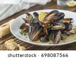 mussels cooked with lemon and... | Shutterstock . vector #698087566