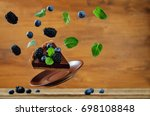 flying chocolate tart with... | Shutterstock . vector #698108848