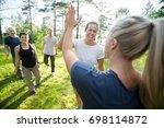 women giving high five while... | Shutterstock . vector #698114872