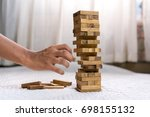 young man pulling out wood... | Shutterstock . vector #698155132