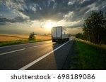 truck driving on the asphalt... | Shutterstock . vector #698189086