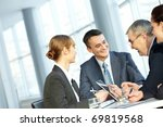 four businesspeople sitting at... | Shutterstock . vector #69819568