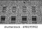 old lava brick building with... | Shutterstock . vector #698195902