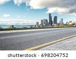 empty asphalt road with... | Shutterstock . vector #698204752