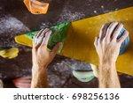closeup of rock climber's hands ...   Shutterstock . vector #698256136