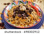 pilaf with mutton  carrots ... | Shutterstock . vector #698302912