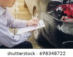 insurance agent working on car... | Shutterstock . vector #698348722