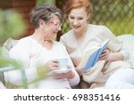 happy grandma in glasses... | Shutterstock . vector #698351416