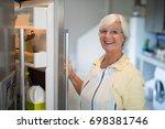smiling senior women opening... | Shutterstock . vector #698381746