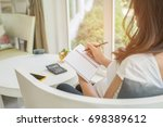 pregnant woman writing in... | Shutterstock . vector #698389612