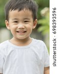 close up smiling face of asian... | Shutterstock . vector #698393596