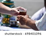 hand transferring a disposable... | Shutterstock . vector #698401096