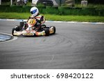 go kart driver on the circuit... | Shutterstock . vector #698420122