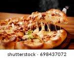 slice of pizza cheese crust...   Shutterstock . vector #698437072