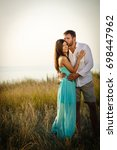 young woman and her husband... | Shutterstock . vector #698447962