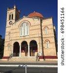 Small photo of AEGINA, GREECE - JULY 11, 2017: An ancient big church on Aegina island in the Mediterranean Sea.