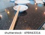 wooden chopsticks on a white... | Shutterstock . vector #698463316