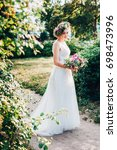 beautiful bride in a light and... | Shutterstock . vector #698473996