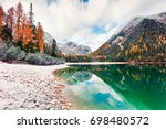 first snow on braies lake.... | Shutterstock . vector #698480572