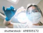 portrait of female dentist .... | Shutterstock . vector #698505172