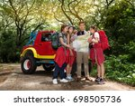 traveller looking on the map... | Shutterstock . vector #698505736