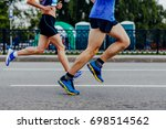 male and female runners running ... | Shutterstock . vector #698514562