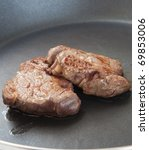 two beef steak in a frying pan - stock photo