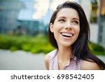 girl laughs   Shutterstock . vector #698542405