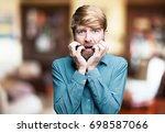 young scared blonde man. sad... | Shutterstock . vector #698587066