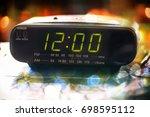black digital alarm radio clock.... | Shutterstock . vector #698595112