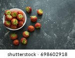 Strawberries In A Bowl On A...