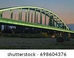 Illuminated Train Bridge Over...