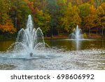 two fountains in a pond... | Shutterstock . vector #698606992