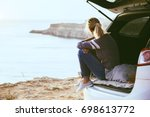 woman relaxing inside car trunk ... | Shutterstock . vector #698613772