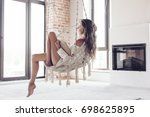 young woman chilling at home in ... | Shutterstock . vector #698625895