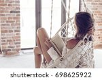 young woman chilling at home in ...   Shutterstock . vector #698625922