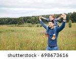 happy cute daughter... | Shutterstock . vector #698673616