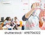 young girls sitting at desktop... | Shutterstock . vector #698706322