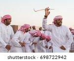 men perform a yawalah... | Shutterstock . vector #698722942